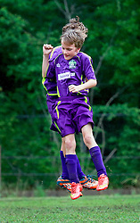 12 April 2015. Hammond, Louisiana.<br /> New Orleans Jesters Champions! <br /> U10 New Orleans Jesters Elites, team purple defeat MP U10-Rodolfo 7-0 to win their division in the Strawberry Cup hosted by the South Tangipahoa Youth Soccer Association (STYSA).<br /> Photo; Charlie Varley/varleypix.com