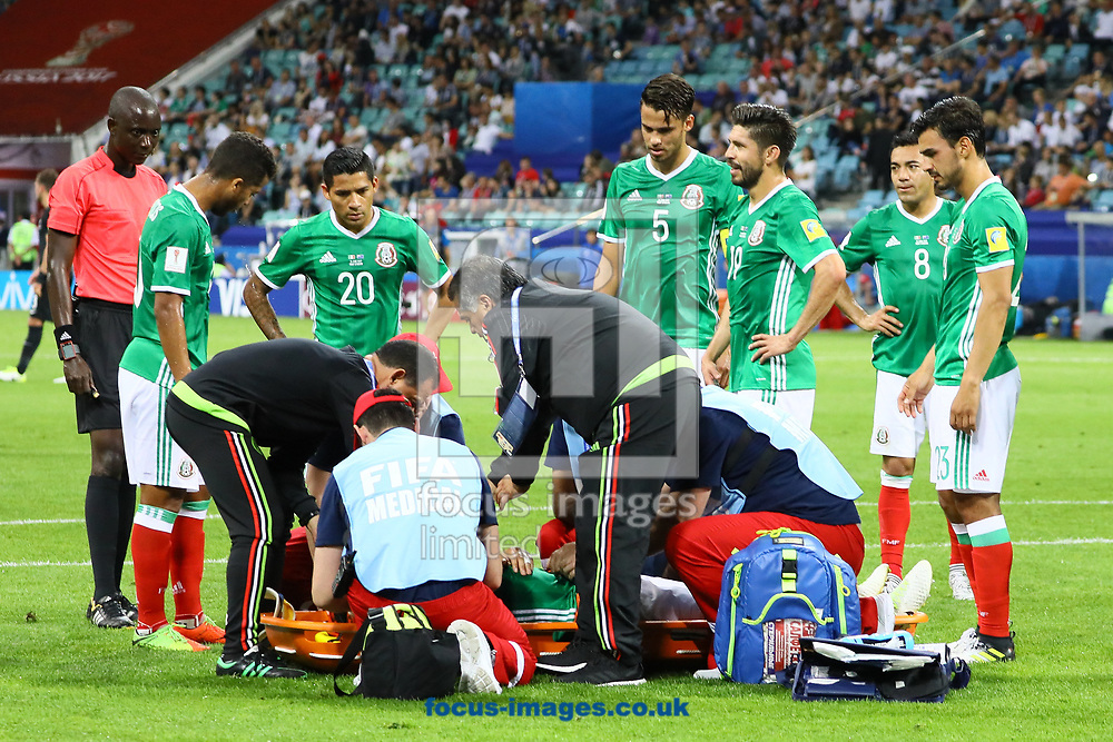 Carlos Salcedo of Mexico injures his shoulder and is carried off the field during the 2017 FIFA Confederations Cup match at Fisht Stadium, Sochi<br /> Picture by EXPA Pictures/Focus Images Ltd 07814482222<br /> 22/06/2017<br /> *** UK &amp; IRELAND ONLY ***<br /> <br /> EXPA-EIB-170622-0061.jpg