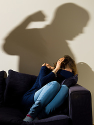 PICTURE POSED BY MODEL File photo dated 9/3/2015 of a shadow of a man with a clenched fist as a woman cowers in the corner. A new £8 million fund is being set up to help children affected by domestic abuse.