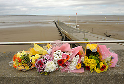 © Licensed to London News Pictures. 20/08/2012. Burnham-on-Sea, Somerset, UK.  Flowers are placed on the sea front near where a 4 year old boy fell off beach jetty on Sunday night.  Emergency services are now working on the basis of recovering a body. The area has one of the highest tidal ranges in the world with strong currents especially around the jetty.  20 August 2012..Photo credit: Simon Chapman/LNP