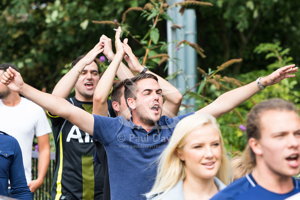 London, August 20 2017. Spurs fans chant slogans as they make their way to the game as Tottenham Hotspur host their first game of the Premier League season at their temporary home ground, Wembley Stadium, hosting Chelsea FC. © Paul Davey.