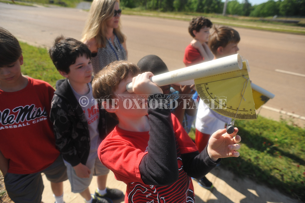 Sam Copley measures the height of a rocket launch at Della Davidson Elementary in Oxford, Miss. on Wednesday, May 8, 2013.