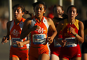 Oct 20, 2006; Walnut, CA, USA; Corina Ubario (center) and Denise Nunez (left) of St. Joseph compete in the girls Division III sweepstakes race over the 2.91-mile course in the 59th Mt. San Antonio College Cross Country Invitational.