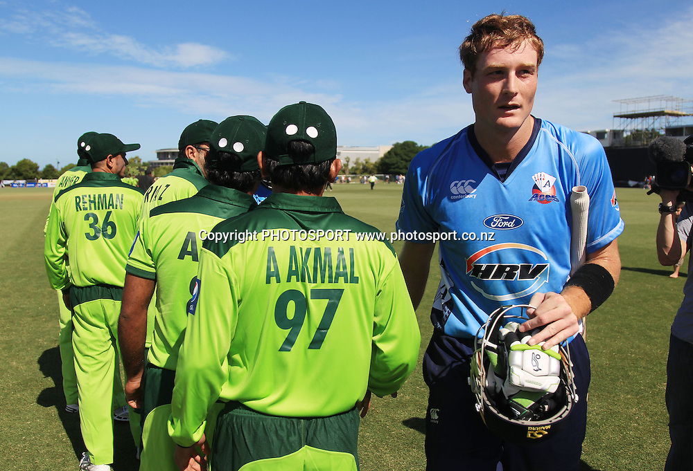 Auckland's Martin Guptil leaves the field after defeating Pakistan. Twenty20 Cricket, Auckland Aces v Pakistan, Colin Maiden Park, Auckland. Thursday 23 December 2010.Photo: Andrew Cornaga/photosport.co.nz