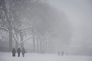 Local walkers brave freezing temperatures in a bleak mid-winter landscape. During a prolonged cold spell of bad weather, snow fell continuously on the capital days before, allowing families the chance to enjoy the bleak conditions in Ruskin Park in the borough of Lambeth.