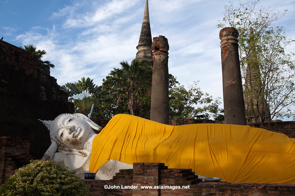 Reclining Buddha at Wat Yai Chai Mongkhan - Wat Yai Chai Mongkhon or the Great Monastery of Auspicious Victory was also known by other names: Wat Pa Kaeo, Wat Chao Phraya Thai and Wat Yai Chaya Mongkhon.  The chedi of Wat Yai Chai Mongkhon is one of the landmarks of Ayutthaya.