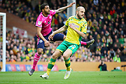 QPR defender Darnell Furlong (2) clears in front of Norwich City forward Teemu Pukki (22)  during the EFL Sky Bet Championship match between Norwich City and Queens Park Rangers at Carrow Road, Norwich, England on 6 April 2019.