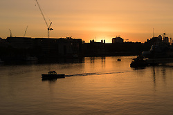 © Licensed to London News Pictures. 08/09/2016. LONDON, UK.  Clear colourful sky is seen as dawn breaks and the sun rises on the River Thames the morning. Warm autumn weather is forecast again today. Photo credit: Vickie Flores/LNP