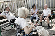 Ms. Bouloi and her husband take the two elderly people they look after with their granddaughter to a recreation park called Lan Pho Mueng Pattaya Park.&nbsp;<br /> <br />&copy; Giulio Di Sturco<br />Pattay, Thailand 2016