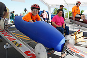 Competitors prepare for a heat at a local soapbox derby race on Lakeshore Boulevard in Irondequoit on Saturday, May 31, 2014. Eighty-two competitors raced in six divisions, with the winner of each division advancing to the world championships in Akron, Ohio.