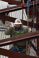 Mark Harmon talks on his cell phone as he works on the Oakland Avenue Viaduct in Sharon, PA.