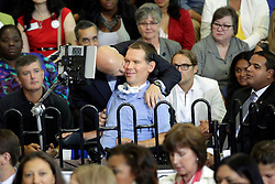 27 August 2015. Andrew P. Sanchez & Copelin-Byrd Multi Service Center, Lower 9th Ward, New Orleans, Louisiana.<br /> Mayor Mitch Landrieu with Steve Gleason, former pro football player with the NFL's New Orleans Saints awaiting remarks  from President Obama. Gleason who suffers from ALS is founder of the Gleason Initiative Foundation.<br /> Photo credit©; Charlie Varley/varleypix.com.