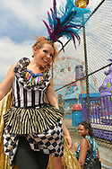 Brooklyn, New York, USA. 10th August 2013. Stilt walker KAE BURKE, of Lady Circus, wears a fancy dress and gold cape costume, as she walks high on stilts during the 3rd Annual Coney Island History Day celebration.