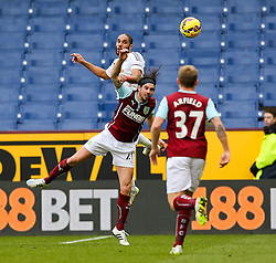 Burnley's George Boyd challenges for a header with Ashley Williams of Swansea City - Photo mandatory by-line: Matt McNulty/JMP - Mobile: 07966 386802 - 28/02/2015 - SPORT - Football - Burnley - Turf Moor - Burnley v Swansea City - Barclays Premier League