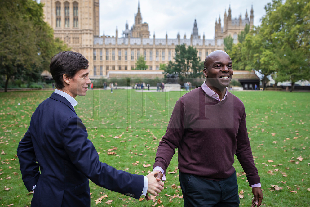 © Licensed to London News Pictures. 04/10/2019. London, UK. Rory Stewart (L) shakes hands with Conservative candidate in the London 2020 Mayoral Election Shaun Bailey (R) as they pass in Westminster. Rory Stewart has announced his resignation from the Conservative Party and his intention to stand as an independent candidate for Mayor of London. Photo credit: Rob Pinney/LNP