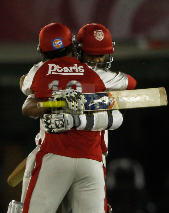 Kings XI Punjab Paul Valthaty and Dinesh Karthik celebrates victoey during match 9 of the Indian Premier League ( IPL ) Season 4 between the Kings XI Punjab and the Chennai Super Kings held at the PCA stadium in Mohali, Chandigarh, India on the 13th April 2011..Photo by Pankaj Nangia/BCCI/SPORTZPICS