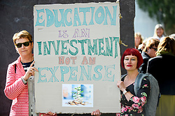 © Licensed to London News Pictures. 28/09/2018. LONDON, UK. Head teachers with a placard join hundreds of other head teachers at a rally in Parliament Square to demand extra funding for schools ahead of a petition being delivered to Number 11 Downing Street.  With a reported reduction in per student funding in real terms since 2010, members of the National Union of Head Teachers and the Association of School and College Leaders attending the rally also warn of increasing class sizes, staff cuts, and reduced subject choice.  Photo credit: Stephen Chung/LNP