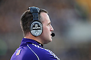 October 15, 2011: Northwestern Wildcats head coach Pat Fitzgerald watches action on the field during the first half of the NCAA football game between the Northwestern Wildcats and the Iowa Hawkeyes at Kinnick Stadium in Iowa City, Iowa on Saturday, October 15, 2011. Iowa defeated Northwestern 41-31.
