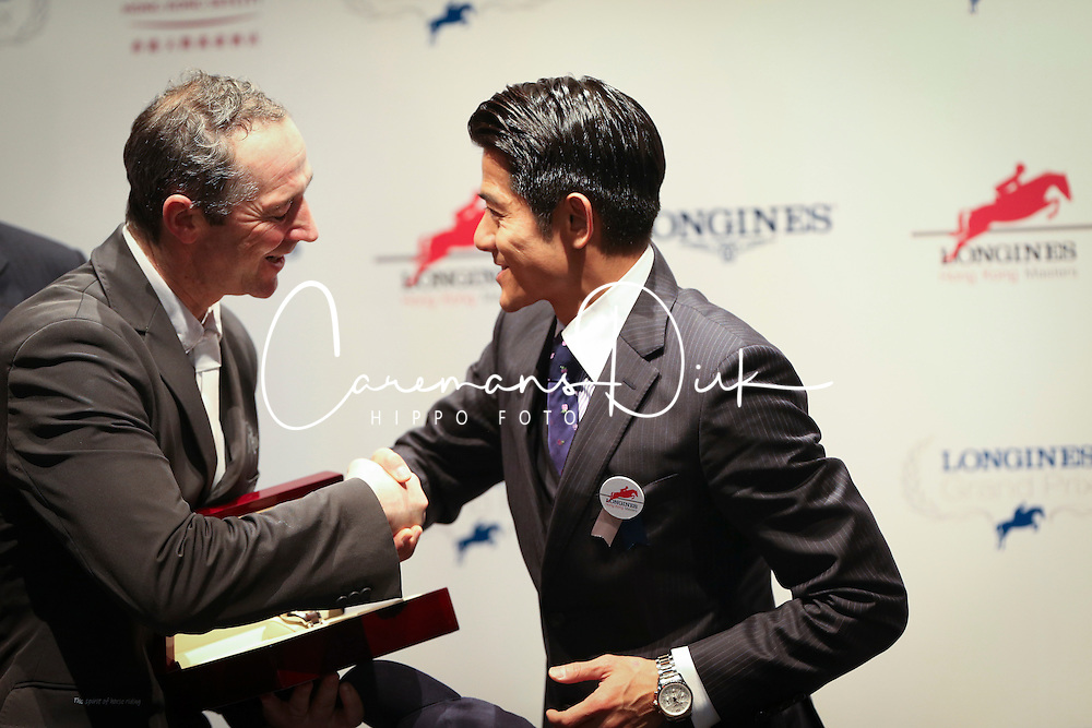 Delaveau Patrice (FRA) and Hong Kong star Aaron Kwok<br /> CSI 5* Longines Hong Kong Masters 2013<br /> Winner of the Longines Grand Prix<br /> © Hippo Foto - Counet Julien
