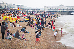 © Licensed to London News Pictures. 28/05/2017. Brighton, UK. Members of the public brave the grey clouds to spend some time on the beach in Brighton and Hove on the Bank holiday weekend. Photo credit: Hugo Michiels/LNP
