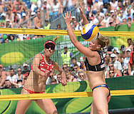 STARE JABLONKI POLAND - July 6: Britta Buthe of Germany  and April Ross of USA in action during Day 6 of the FIVB Beach Volleyball World Championships on July 6, 2013 in Stare Jablonki Poland.  (Photo by Piotr Hawalej)