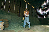 Lifestyle image of rancher taking a break from baling hay in San Diego, CA.