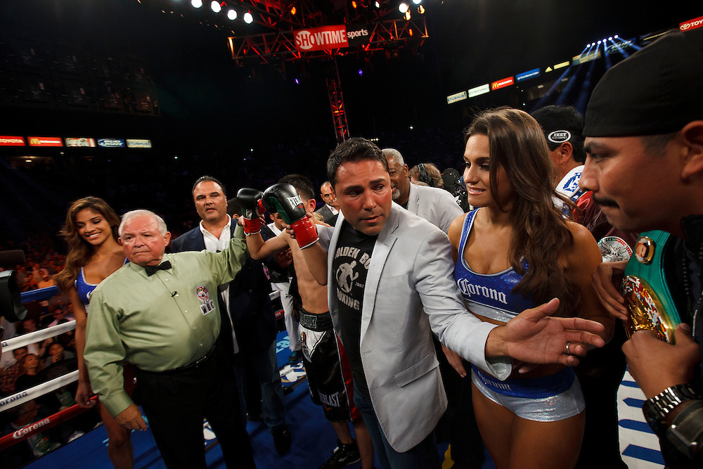 Oscar De La Hoya, as promoter of the fight, poses for a picture with Leo Santa Cruz, and referee Lou Moret, left, after Santa Cruz knocked out Victor Terrazas for the WBC Super Bantamweight Title Fight at the StubHub Center on Saturday, August 24, 2013 in Carson, California. Patrick T. Fallon/For The New York Times