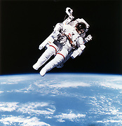 US Astronaut Bruce McCandless on Mission 41-B on extravehicular space movement using first nitrogen-propelled, hand-controlled, tether-free device, giving greater mobility to. spacewalkers. 1984.  NASA photograph