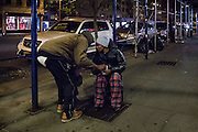"24 November 2013 - New York, NY [Austin ""Guy"" Butler finds a heating grate for his girlfriend.] 11/24/13 Stoneham/CUNY Journalism Photo"