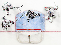 Omaha, Nebraska --<br /> <br /> UNO right wing Austin Ortega, No. 16, scores in the third period during the Mavericks' game against St. Cloud State at Baxter Arena on Saturday, Feb. 20, 2016, in Omaha. St. Cloud State defeated Omaha 6-3.<br /> <br /> (MATT DIXON/THE WORLD-HERALD)