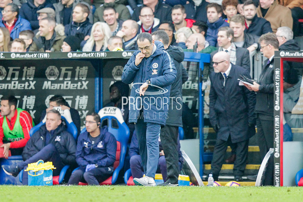 Chelsea manager Maurizio Sarri checks his watch during the Premier League match between Crystal Palace and Chelsea at Selhurst Park, London, England on 30 December 2018.