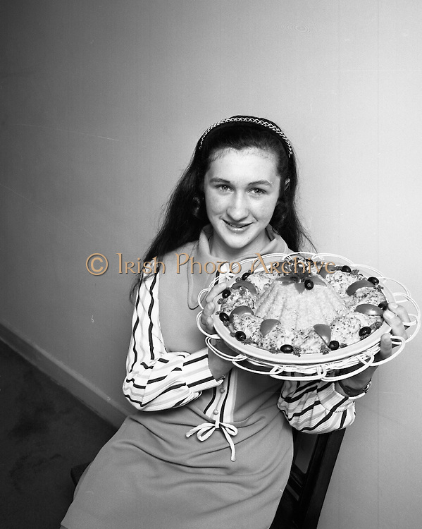"B.I.M.National Seafood Cook..1972..05.05.1972..05.05.1972..5th May 1972..The final of the ""National Seafood Cook 1972"" was held in the Great Southern Hotel,Killarney,Co Kerry.The winner was Miss Mary Coleman (14 years)from the Vocational School, Claremorris,Co Mayo.The title of the winning dish was ""Amber Ring. She was chosen from 18 regional finalists...Image of the competition winner,Mary Coleman (14 years),with her award winning entry,""Amber Ring""."