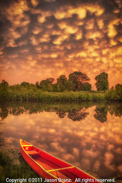 Mammatus at sunset over a lake in rural Missouri.