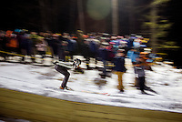 A skier heads down the shute during Plymouth High School's ski jump meet on Friday evening.  (Karen Bobotas/for the Laconia Daily Sun)
