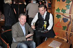 Left to right, FRANK GARDNER and STEFAN BOOTH at One Night Only at The Ivy held at The Ivy, 1-5 West Street, London on 2nd December 2012.