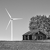 Wind turbine in rural location with old barn in Cavalier County USA