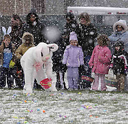 The Easter bunny entertains prior to the beginning of an Easter egg hunt sponsored by the Montgomery County Sheriff's Office Police Athletic League, Saturday morning..