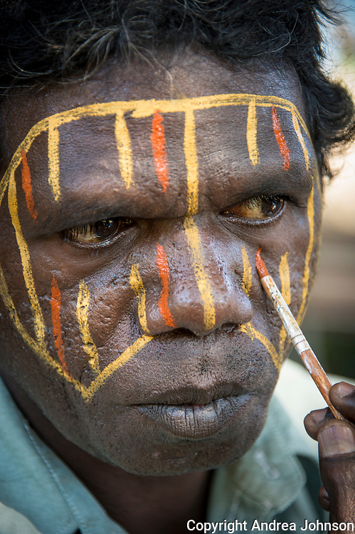 Elder Aboriginal man preparing for traditional ceremony, Tiwi Islands, Northern Territory, Australia