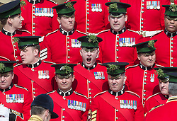 LONDON - UK - 17th Mar -2016: A soldier yawns during preparations for the group photograph for the visit by HRH The Duke of Cambridge, Royal Colonel of the 1st Battalion Irish Guards  who attends the annual St Patrick's Day Parade at the barracks in West London. Prince William takes the salute and presents Shamrocks to serving soldiers. After the parade Prince William posed for the regimental photograph.<br /> <br /> Photograph by Ian Jones