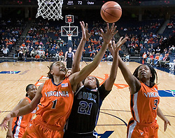 Virginia Cavaliers Forward Lyndra Littles (1)and Virginia Cavaliers Guard Paulisha Kellum (3) fight with Duke Blue Devils Forward Joy Cheek (21) for a rebound.  The University of Virginia Cavaliers lost to the #1 ranked Duke University Blue Devils 76-61 at the John Paul Jones Arena in Charlottesville, VA on February 2, 2007.