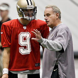 July 27, 2012; Metairie, LA, USA; New Orleans Saints quarterback Drew Brees (9) with assistant head coach and linebackers coach Joe Vitt during training camp at the team's indoor practice facility. Mandatory Credit: Derick E. Hingle-US PRESSWIRE