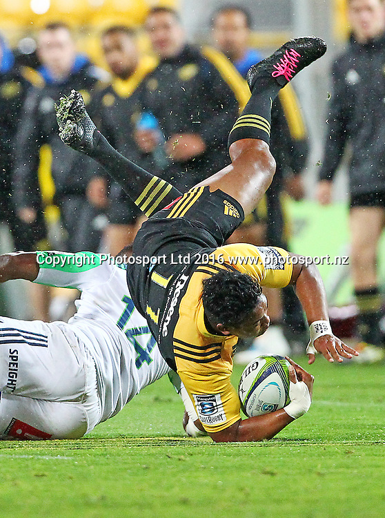 Hurricanes' Julian Savea is tackled by Highlanders' Waisake Naholo during the Round 14 Super Rugby match, Hurricanes v Highlanders at Westpac Stadium, Wellington. 27th May 2016. Copyright Photo.: Grant Down / www.photosport.nz