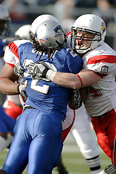 25 November 2006: Norris Smith is stood up and stopped by Niall Campbell. The Redbirds romped the Panthers by a score of 24-13.&#xD;This game was a 1st round NCAA Division 1 Playoff held at O'Brien Stadium on the campus of Eastern Illinois University in Charleston Illinois.<br />
