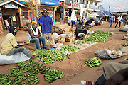 Men selling matooke on the side of the road in Kampala, Uganda.