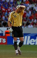 Photo: Glyn Thomas.<br />France v Switzerland. Group G, FIFA World Cup 2006. 13/06/2006.<br /> France's goalkeeper Fabien Barthez looks dejected.