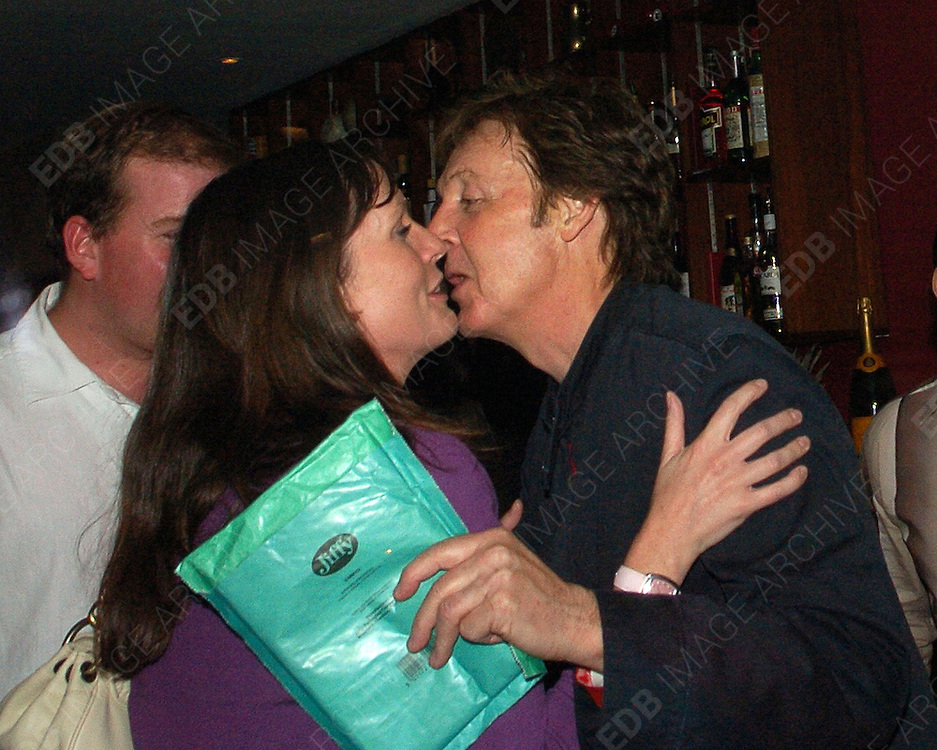 07.JUNE.2007. LONDON<br /> <br /> PAUL McCARTNEY KISSING A MYSTERY WOMEN IN AN INTIMATE CLINCH AT THE AFTERPARTY FOR HIS GIG AT THE ELECTRIC BALLROOM, CAMDEN, THE AFTERPARTY WAS AT MANGO ROOMS CAMDEN.<br /> <br /> BYLINE: EDBIMAGEARCHIVE.CO.UK<br /> <br /> *THIS IMAGE IS STRICTLY FOR UK NEWSPAPERS AND MAGAZINES ONLY*<br /> *FOR WORLD WIDE SALES AND WEB USE PLEASE CONTACT EDBIMAGEARCHIVE - 0208 954 5968*