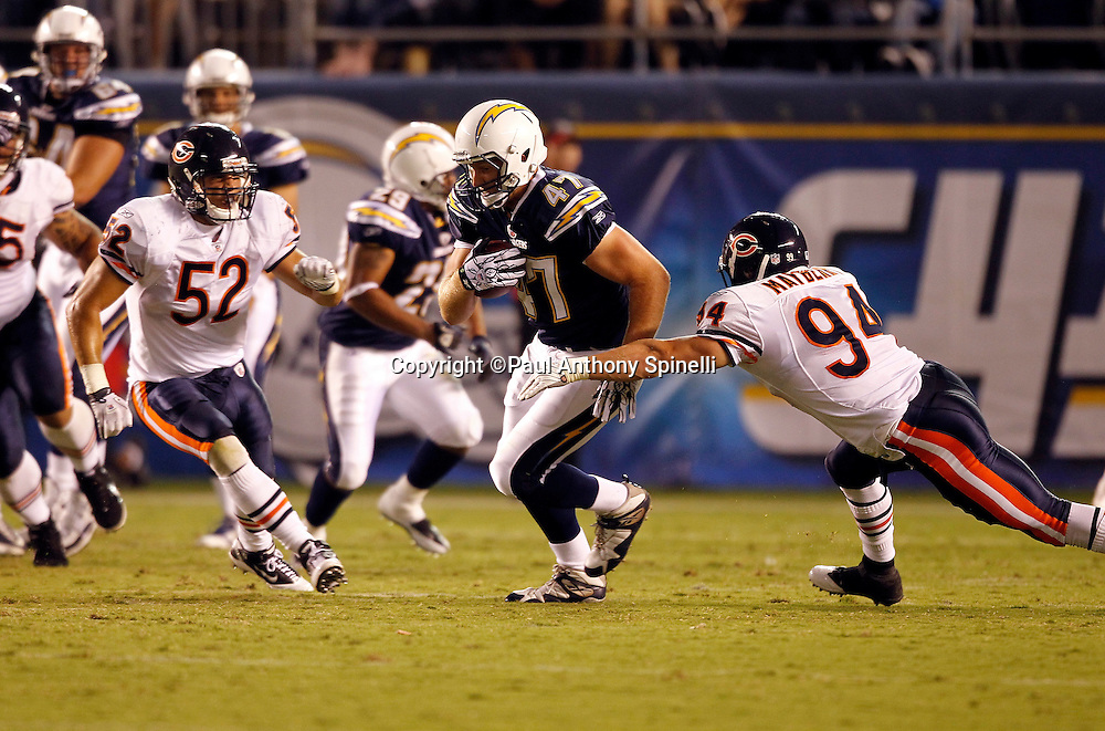 San Diego Chargers tight end Richie Brockel (47) tries to avoid a tackle attempt by Chicago Bears rookie linebacker Matt Mayberry (94) during a NFL week 1 preseason football game against the Chicago Bears, Saturday, August 14, 2010 in San Diego, California. The Chargers won the game 25-10. (©Paul Anthony Spinelli)