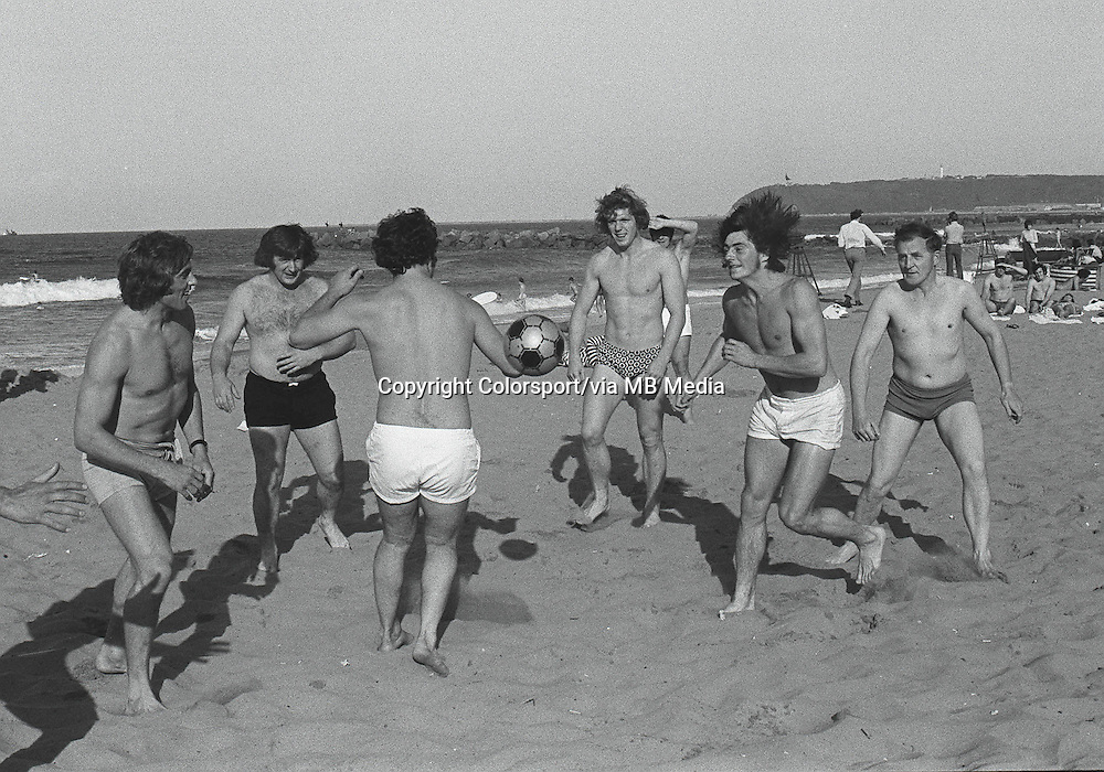 Lions Players relaxes on the beach with a game of Football. L to R. Tony Neary,Stewart McKinney,Fergus Slattery,Bobby Windsor and Andy Irvine, Unknown (right) British Lions Tour of South Africa 1974. Credit : Colorsport