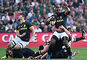JOHANNESBURG, South Africa, 04 October 2014 : Tendai Mtawarira of the Springboks is tackled by Joe Moody of the All Blacks with Duane Vermeulen of the Springboks tripping over Owen Franks of the All Blacks during the Castle Lager Rugby Championship test match between SOUTH AFRICA and NEW ZEALAND at ELLIS PARK in Johannesburg, South Africa on 04 October 2014. <br /> The Springboks won 27-25 but the All Blacks successfully defended the 2014 Championship trophy.<br /> <br /> © Anton de Villiers / SASPA