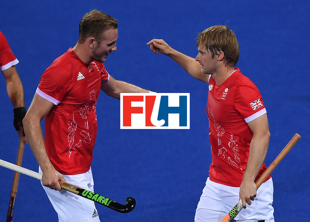 Britain's Ashley Jackson (R) celebrates scoring a goal during the men's field hockey Brazil vs Britain match of the Rio 2016 Olympics Games at the Olympic Hockey Centre in Rio de Janeiro on August, 9 2016. / AFP / MANAN VATSYAYANA        (Photo credit should read MANAN VATSYAYANA/AFP/Getty Images)